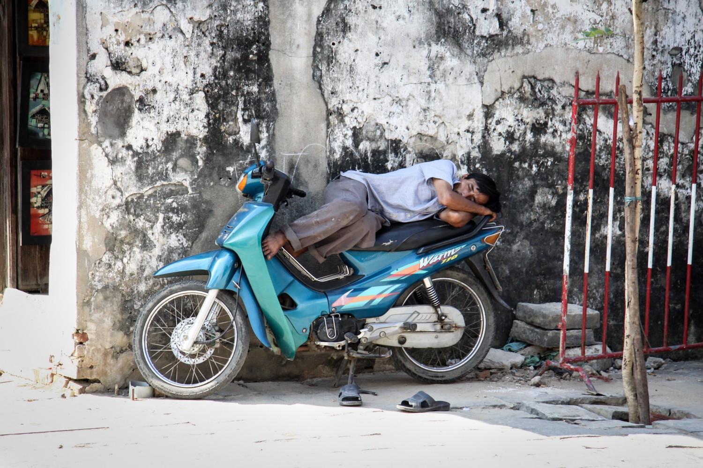 Taking a nap on a bike in Vietnam