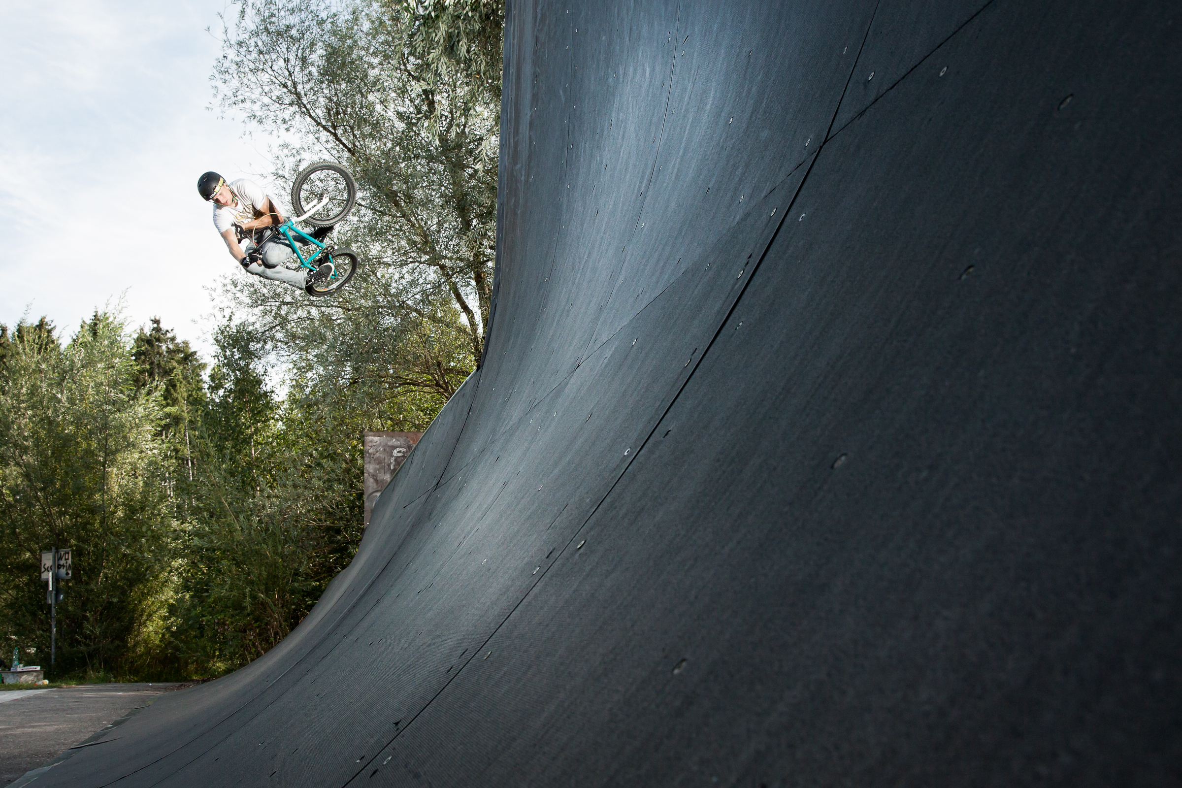 Outdoor action photography of a BMX rider. Sport photography, BMX, Skate.